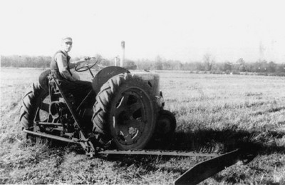 Henry Schriver, shown here driving a tractor and operating farming equipment, organized 4-H and Future Farmers of America members to clean up Grafton Township crop fields following the devastating Palm Sunday tornado in 1965..  (Photo courtesy of the family.)
