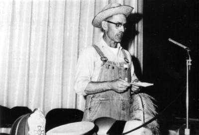 """Henry Schriver, pictured giving a speech titled """"A Farmer Wears Many Hats,"""" often said, """"A farmer is a businessman in overalls."""" (Photo courtesy of the family.)"""