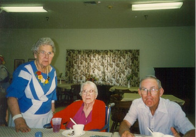 Henry Schriver, right, and his sisters, Sarah Diedrick and Elsie Schriver, at Henry's 90th birthday celebration at Belden United Methodist Church in 2004. Both sisters, along with another sister Mary Frances Mills, are deceased. Henry's remaining sister Martha Jane Williams lives in Michigan.  (Photo courtesy of the family.)