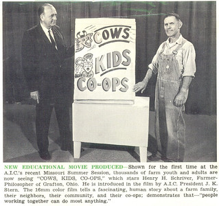 """This newspaper clipping from 1965 shows Henry Schriver, right, with the charts he used in his """"Cows, Kids, Co-ops"""" program. The caption suggests that the man on the left is American Institute of Cooperation president J.K. Stern, who introduced Henry in a film presentation of his popular talk. (Photo courtesy of the family.)"""