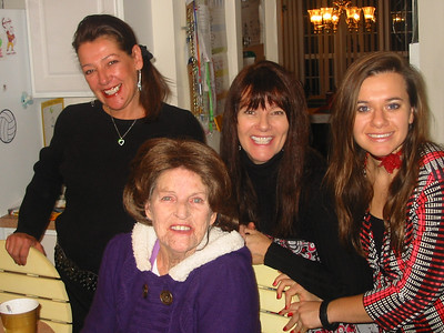 Jeanne Krenek sits in front of her daughters, Susie and Jacqui, and granddaughter Ashley. (Photo courtesy of the family.)