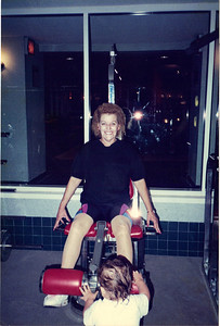 Jeanne Krenek shows a grandchild how to use exercise equipment. (Photo courtesy of the family.)