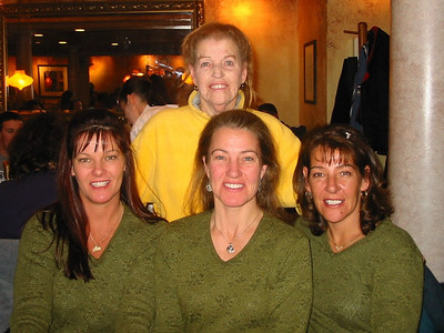 Jean Krenek stands behind her daughters, Jacqui, Jill and Susie. (Photo courtesy of the family.)