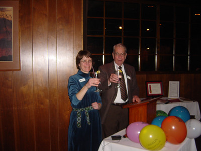 Oberlin Heritage Center Executive Director Pat Murphy (left) and Board President Jin White (right) toast the Heritage Center's accreditation by the American Association of Museums in February 2006. (Photo courtesy of Oberlin Heritage Center.)