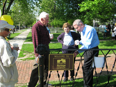 Jim White, Walt Edling and others admire the Morgan Street bridge railings-turned-fence at a special Oberlin Heritage Center dedication ceremony in May 2009. (Photo courtesy of Oberlin Heritage Center.)