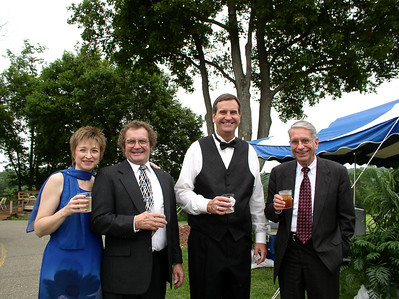 Jim White, right, celebrates a family wedding in 2001 with (from the left) Marilyn and Bill McKelvey (Bill is Jim's second cousin) and Jack Kigerl, who is married to Jim's second cousin Jeanne. (Photo courtesy of the family.)