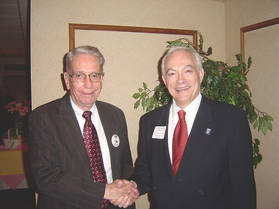 Host James W. White, president of the Oberlin Heritage Center (left), and speaker, William K. Laidlaw Jr., president of the Ohio Historical Society, shake hands before the Oberlin Heritage Center Annual Meeting in April 2006. (Photo courtesy of Oberlin Heritage Center.)