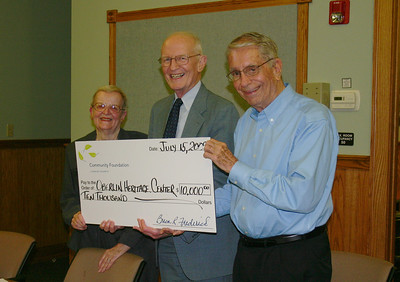 Jim White (right) accepts a Community Foundation grant to support History Education at the Oberlin Heritage Center in July 2009. (Photo courtesy of Oberlin Heritage Center.)