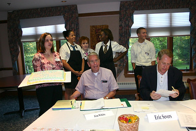 The Oberlin Heritage Center Board surprises Jim White (seated left) with a cake for his 80th birthday at the September 2004 Board meeting. (Photo courtesy of Oberlin Heritage Center.)