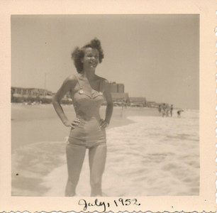 Joan Gambis enjoys the sand and sea at Virginia Beach, Va., in 1952.