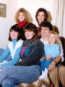 Joan Park, seated on the right and holding granddaughter Alana, poses with some of the other women of the Park family. Standing are, from the left, granddaughter Amber and daughter Denise. Seated from the left are daughter-in-law Carla and daughter Janine. (Photo courtesy of the Park family.)