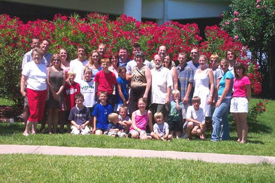 Joan Park, standing on the extreme left and wearing red pants, and the entire Park clan showed up in Texas in 2003 for a family reunion. (Photo courtesy of the Park family.)