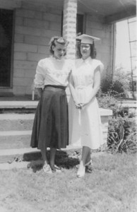 Josey Speckhart, left, helps her sister, Joan Gambis, right, celebrate her graduation from Amherst High School in 1950. (Photo courtesy of the Park family.)