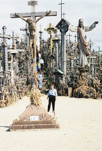 Joan Park visits the Hill of Crosses near the city of Siauliai in northern Lithuania, where visitors make pilgrimages from around the world to leave crosses and other religious imagery of all sizes. (Photo courtesy of the Park family.)