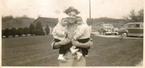 Evelyn Steingass holds her twin sons, Bob and Bill, in 1943.