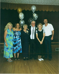 Betty and Sonny Baker, center, celebrate their 50th wedding anniversary with their five children - Debbie, Mick, Fran and Tom - in 2004.