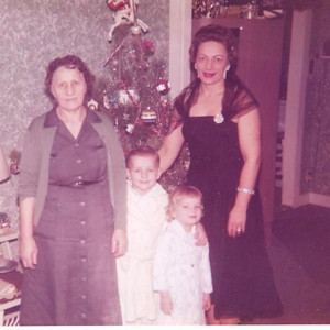 Mae Dillworth, right, and her kids, Jerry and Veronica, celebrate Christmas with her mother, Alice Pulaski, left, around 1960.