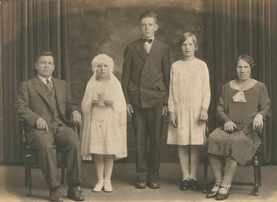 The Pulaski family poses on the occasion of Mae Pulaski's First Holy Communion around 1930. From the left, are Walter (father), Mae, Mae's brother, Chester, sister, Jessie, and mother, Alice.