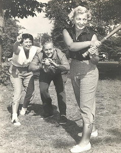 Mae Dillworth, an intense Cleveland Indians fan, plays ball with friends at a picnic.
