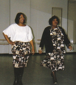 Maggie Terry, right, and Indiana Smith, left, model outfits that Maggie designed at a fund-raising fashion show.