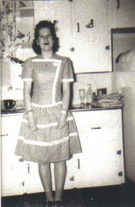 Marie Stang, farm wife and 4H advisor, looks like Betty Crocker standing in the kitchen of her Elyria Township home in the 1950s.