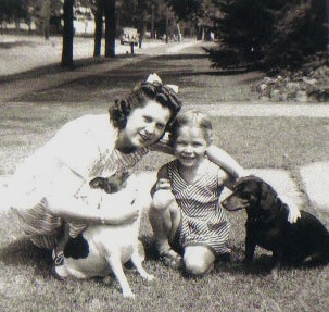 """Marie Stang and her dog, Skippy, play with Marie's cousin Cheryl Barck and her dog. (Yes, her dog-loving cousin's surname is """"Barck."""")"""