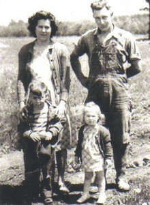 Marie and Frank Stang take a break from farm chores with their two eldest children, Gary and DeAnn, on their farm on West Ridge Road in Elyria Township around 1950.