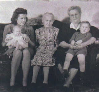Three generations of the Bartlome family: From the left, Marie Stang, holding her baby DeAnn Stang, Marie's grandmother, Magdalena Bartlome, and Marie's mother, Emma Telzerow, holding Marie's firstborn, Gary Stang.