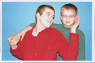 Photographer Kevin Finke tried to get a photo of Micah Black, left, by himself for a church directory for Chestnut Ridge Baptist Church in Elyria, but Micah would not be parted from his younger brother, Christopher, right.