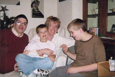 Michael, Christopher, Diane and Micah Black at Christmastime.