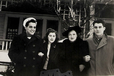 The Arthrell brothers stand with their wives in front of their parents' house in Lorain in 1941. From the left: Bob, Rae, Millie and George. (Photo courtesy of Arthrell family.)