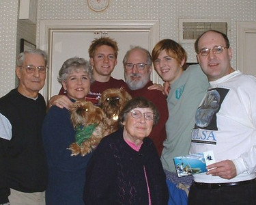 Millie Arthrell, front and center, with family on Christmas 2002. From the left, behind Millie, are her husband, George; daughter-in-law, Claudia; grandson Justin; son Dan; grandson Michael; and son Bill. (Photo courtesy of Arthrell family.)