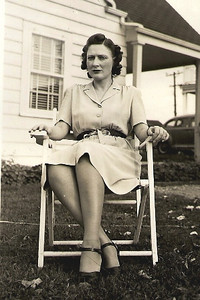 Millie Arthrell sits outside her home in Elyria around 1946. (Photo courtesy of the Arthrell family.)