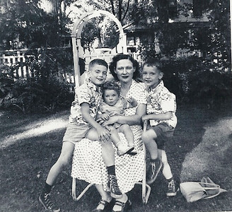 Millie Arthrell, with her niece, Charmaine Chase, on her lap, her son Dan on the left and her son Bill on the right around 1953. (Photo courtesy of the Arthrell family.)