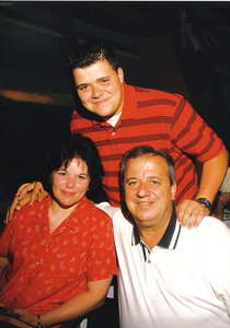 Ziroli family portrait: Seated, Elizabeth and Pat; standing, their son, Anthony. (Photo courtesy of the family.)