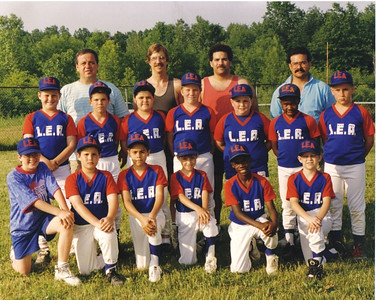 Pat Ziroli, top row, left, helped coach the L.E.A. Lorain Youth Baseball team in the late 1980s. His son, Anthony, is third from the left in the middle row. (Photo courtesy of the family.)