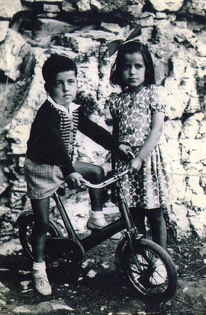 Pat Ziroli, his sister, Bice, and his bicycle in their native Italy. (Photo courtesy of the family.)