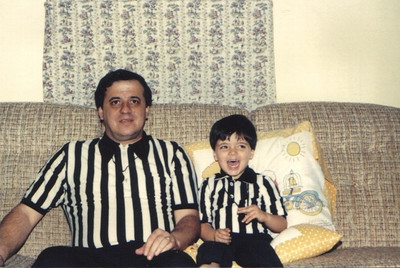 Pat Ziroli,in the striped shirt he wore while officating at basketball games, with his son and would-be official, Anthony. (Photo courtesy of the family.)