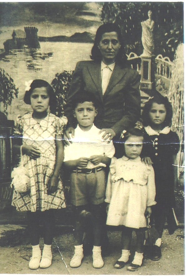 Pat Ziroli, the only boy in the photo, is pictured with him mother, Filomena, his sister, Bice (left) and two cousins in Italy. (Photo courtesy of the family.)