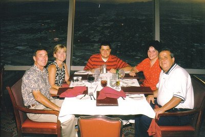 Robert Stephenson, left, was the best man at Pat and Elizabeth Ziroli's wedding in 1981. He and his wife, Mary Pat, who is seated next to him, and the Zirolis' son, Anthony, at the head of the table, traveled to Las Vegas with Elizabeth and Pat (on the right side of the table) to celebrate the couple's 20th wedding anniversary. (Photo courtesy of the family.)