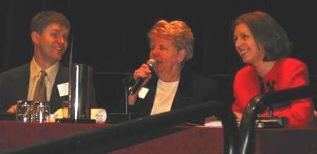 Pat Beattie, center, speaks at a public policy forum.