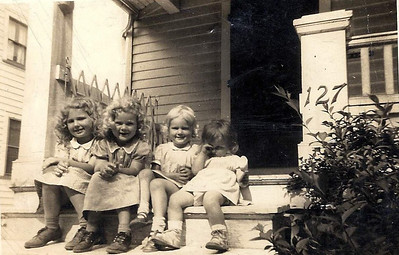 Mason sisters - Pat, Judy, Janice and Mary Lee - on the steps of their home at 127 Bellfield Ave., Elyria, i the early 1940s.