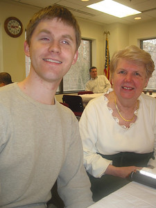 Pat Beattie, right, and a young friend at holiday party in 2006.