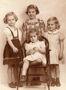 Mason girls, clockwise from left: Judy, Pat, Janice and Mary Lee on chair.