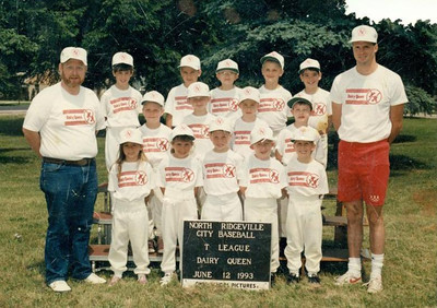 Paul Goode, left, coached the Dairy Queen team in the North Ridgeville City Baseball T League in 1993. His daughter Sarah stands next to him in the front row. (Photo courtesy of the family.)