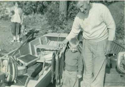 Little Paul Eugene Goode and his father, Paul Edward Goode, show off the fish they caught in Canada in 1956. (Photo courtesy of the family.)