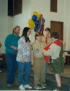 Paul and Diana Goode, left, watch the ritual as their son Gordon advances from Webelo to Boy Scout. (Photo courtesy of the family.)