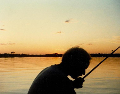 Paul Goode, silhouetted against the waters of the St. Lawrence Seaway in Canada, where he fished many times. (Photo courtesy of the family.)