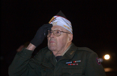(Chronicle file photo) Ray Church gives a final salute to the flag at the last Wellington Dukes home football game of the season in October 2009, when he was inducted into the Wellington Fullbackers Hall of Honor.