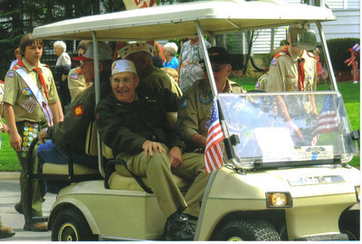 Ray Church rides with other veterans in a Wellington Memorial Day parade about five years ago.